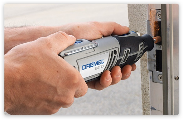 Person using Dremel to drill